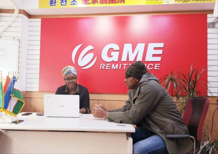 Halimat Isah, left, GME's marketing head for the African region, assists a client from the Democratic Republic of the Congo. Courtesy of GME Remittance