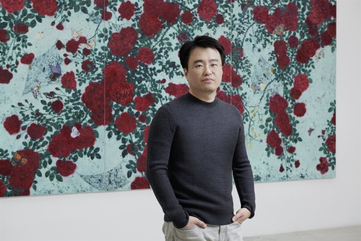 Moon Sung-sic stands in front of his work 'Just Life,' currently displayed at Kukje Gallery in Seoul. Courtesy of Kukje Gallery