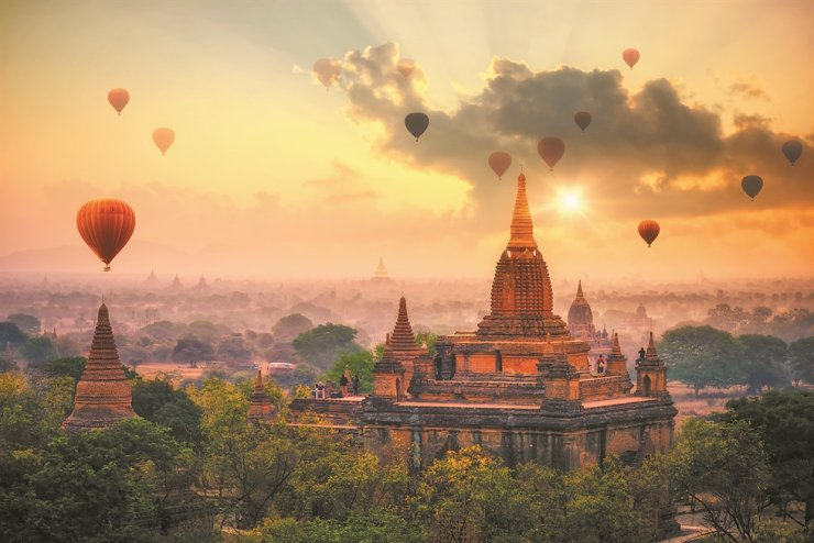 Hot air balloons float above Bagan, an ancient city and a UNESCO World Heritage Site located in the Mandalay, Myanmar. From the ninth to 13th centuries, the city was the capital of the Pagan Kingdom, the first kingdom that unified the regions that would later constitute modern Myanmar. / Courtesy of Myanmar Airways International