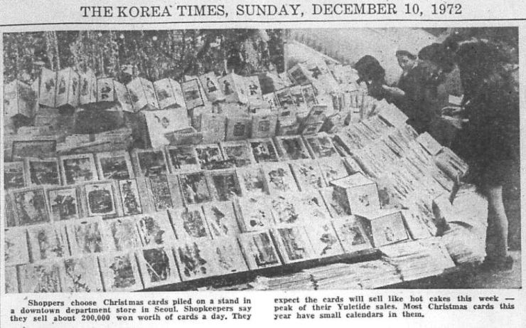 Shoppers choose Christmas cards piled on a stand in a downtown Seoul department store in this photo printed in The Korea Times on Dec. 10, 1972. Most of the cards contained small calendars. / Korea Times archive