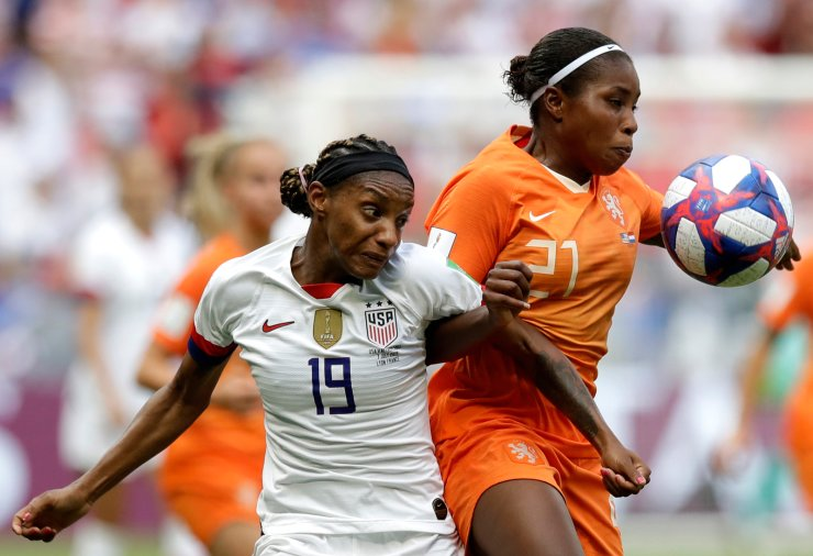 United States' Crystal Dunn, left, challenges Netherlands' Lineth Beerensteyn, right, during the Women's World Cup final soccer match between US and The Netherlands at the Stade de Lyon in Decines, outside Lyon, France, Sunday, July 7, 2019. AP