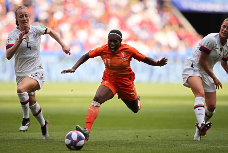Netherlands' Lineth Beerensteyn is fouled by United States' Abby Dahlkemper, right, as United States' Becky Sauerbrunn, left, looks on during the Women's World Cup final soccer match between US and The Netherlands at the Stade de Lyon in Decines, outside Lyon, France, Sunday, July 7, 2019. AP