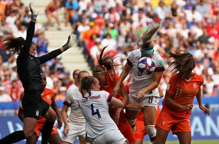 United States' Julie Ertz, 2nd right, heads the ball during the Women's World Cup final soccer match between US and The Netherlands at the Stade de Lyon in Decines, outside Lyon, France, Sunday, July 7, 2019. AP