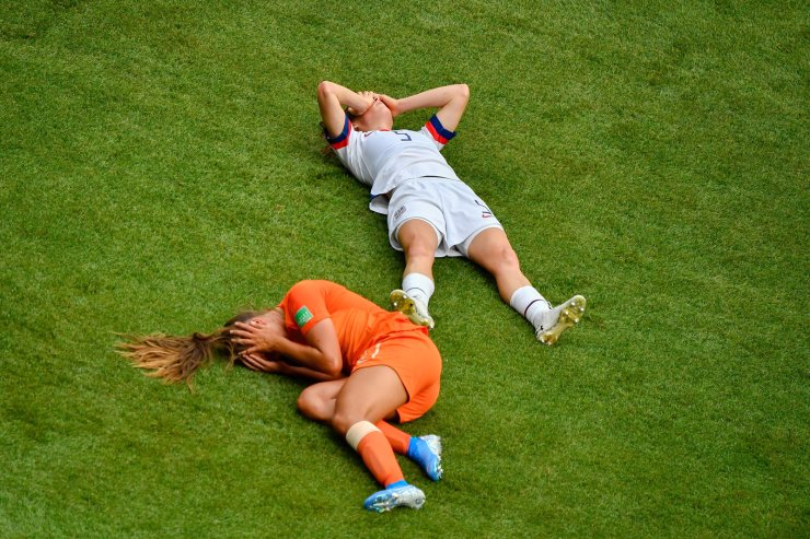 Kelley O' Hara (R) of the United States and Lieke Martens (L) of the Netherlands fall on the ground during the final match between the United States and the Netherlands at the 2019 FIFA Women's World Cup at Stade de Lyon in Lyon, France, July 7, 2019. Xinhua
