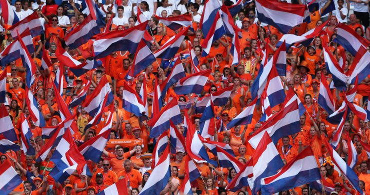 Netherlands supporters wave flags during the Women's World Cup final soccer match between US and The Netherlands at the Stade de Lyon in Decines, outside Lyon, France, Sunday, July 7, 2019. AP