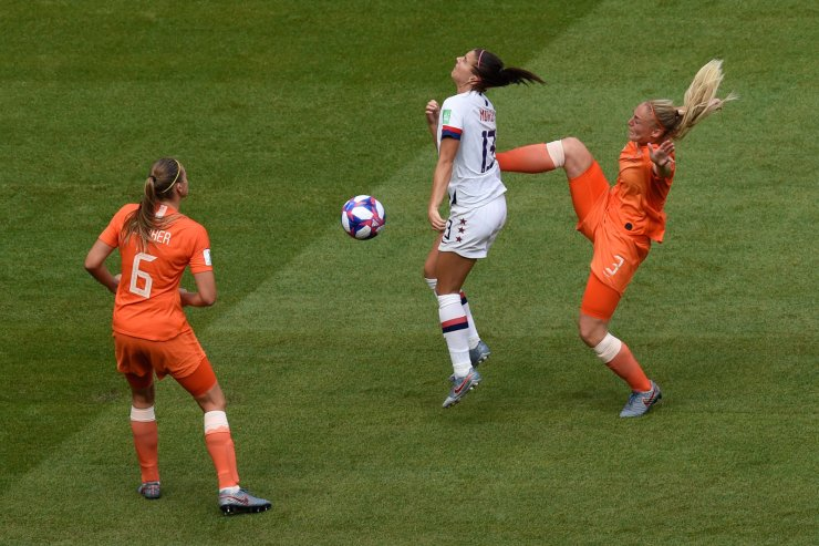 Netherlands' defender Stefanie van der Gragt (R) vies for the ball with United States' forward Alex Morgan (C) during the France 2019 Women's World Cup final football match between USA and the Netherlands, on July 7, 2019, at the Lyon Stadium in Lyon, central-eastern France. AFP