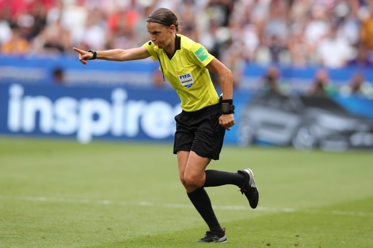 Referee Stephanie Frappart points to the penalty spot after checking the VAR during the Women's World Cup final soccer match between US and The Netherlands at the Stade de Lyon in Decines, outside Lyon, France, Sunday, July 7, 2019. AP