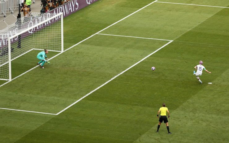 Megan Rapinoe of the U.S. scores their first goal from the penalty spot. Reuters
