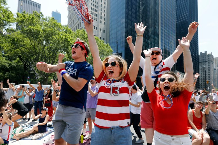 McKall Dodd, foreground center, and Alfredo Calderon, background, join the celebration of the first US goal, at a watch party in New York, Sunday, July 7, 2019, during second half of the US vs. Netherlands Women's World Cup championship match. AP