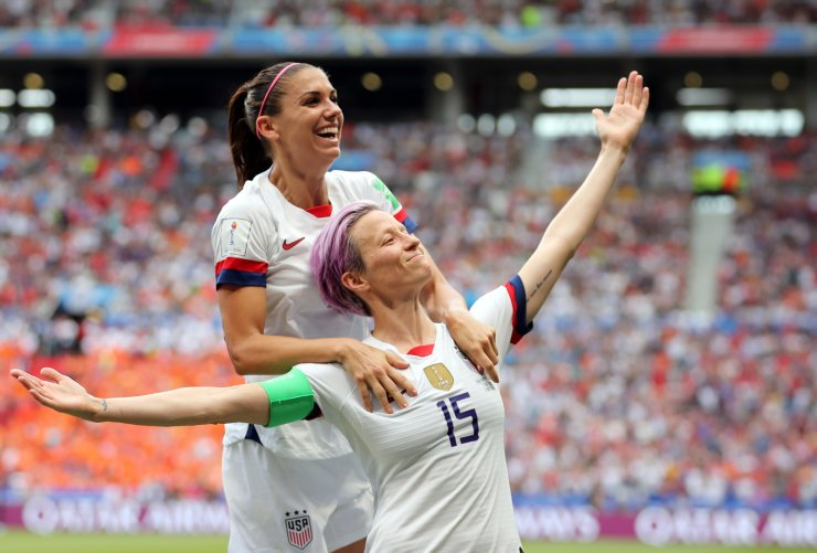 United States' Megan Rapinoe, right, celebrates after scoring the opening goal from the penalty spot during the Women's World Cup final soccer match between US and The Netherlands at the Stade de Lyon in Decines, outside Lyon, France, Sunday, July 7, 2019. AP