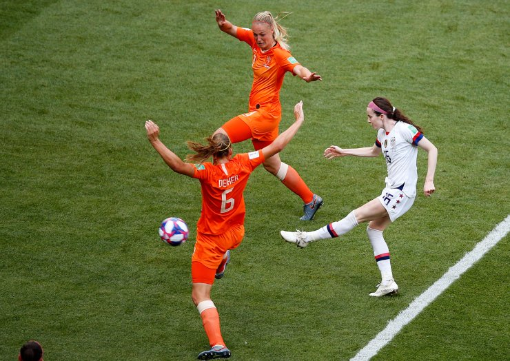 United States' Rose Lavelle , right, shoots to score her side's second goal during the Women's World Cup final soccer match between US and The Netherlands at the Stade de Lyon in Decines, outside Lyon, France, Sunday, July 7, 2019. AP
