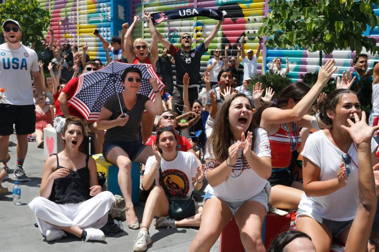 Soccer fans celebrate the second US goal at a watch party in New York, Sunday, July 7, 2019, during second half of the US vs. Netherlands Women's World Cup championship match. AP