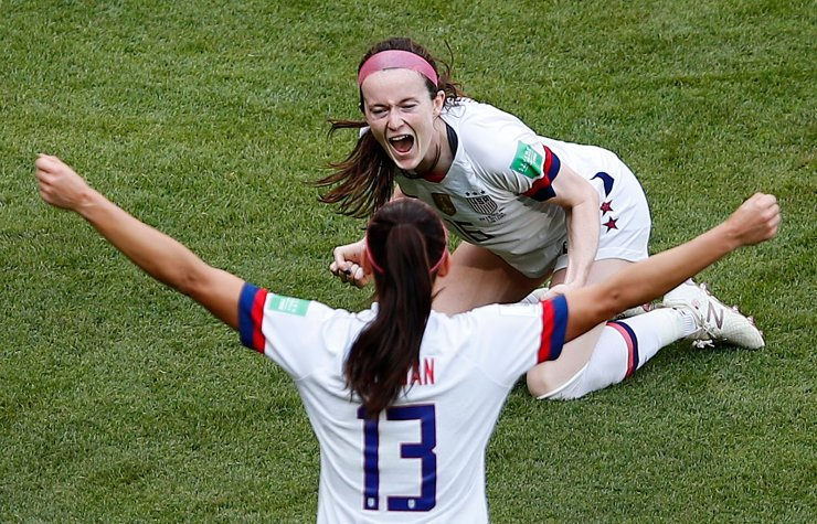 United States' Rose Lavelle and United States' Alex Morgan celebrate after scoring their side's second goal during the Women's World Cup final soccer match between US and The Netherlands at the Stade de Lyon in Decines, outside Lyon, France, Sunday, July 7, 2019. AP