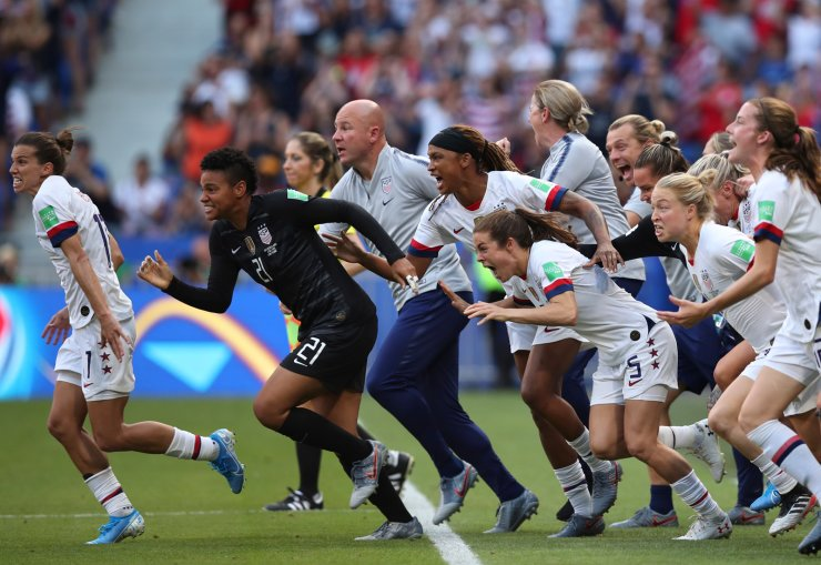 The United States players run on to the pitch celebrating after the final whistle during the Women's World Cup final soccer match between US and The Netherlands at the Stade de Lyon in Decines, outside Lyon, France, Sunday, July 7, 2019. The US defeated the Netherlands 2-0. AP