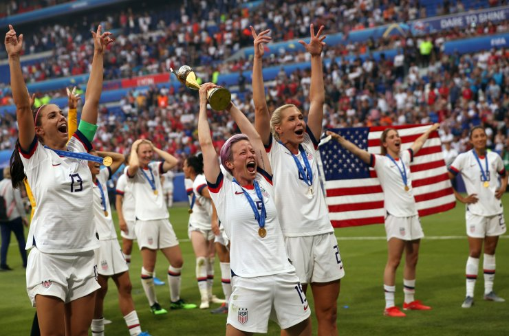 United States' Megan Rapinoe holds the trophy celebrating at the end of the Women's World Cup final soccer match between US and The Netherlands at the Stade de Lyon in Decines, outside Lyon, France, Sunday, July 7, 2019. AP
