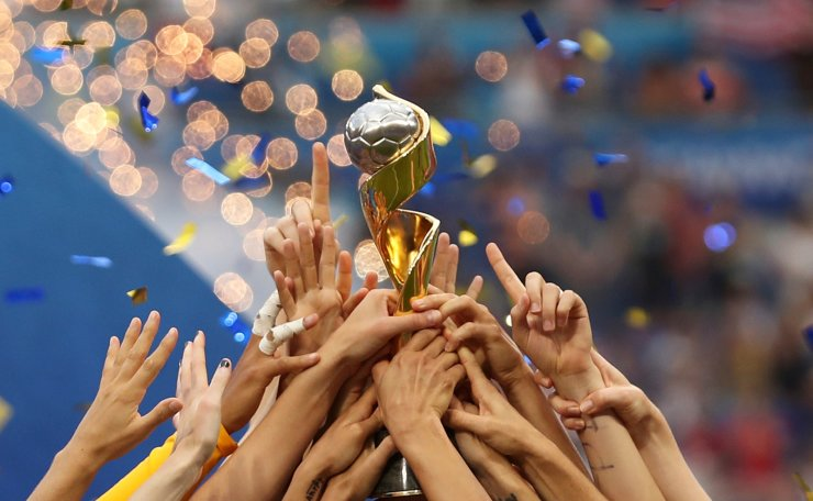 The United States players hold the trophy celebrating at the end of the Women's World Cup final soccer match between US and The Netherlands at the Stade de Lyon in Decines, outside Lyon, France, Sunday, July 7, 2019. The US defeated the Netherlands 2-0. AP