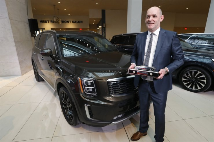 Michael Cole, president of Kia North America, holds the trophy after the Kia Telluride was awarded North American Sport Utility of the Year in Detroit, Monday, Jan. 13, 2020. AP