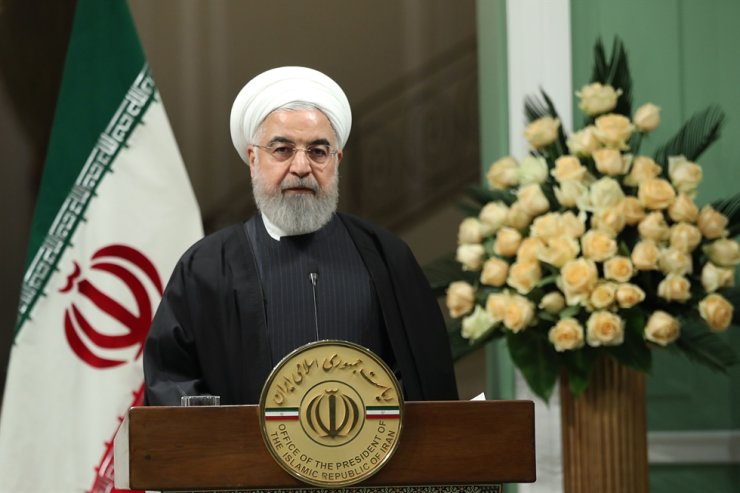 A handout picture provided by the official website of the Iranian Presidency on Jan. 12, 2020, shows Iranian President Hassan Rouhani speaking during a joint press conference with the Emir of Qatar in Tehran. AFP