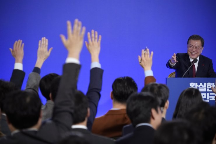 South Korean President Moon Jae-in smiles as reporters raise their hands for questions during his New Year press conference at the presidential Blue House in Seoul, South Korea, Tuesday, Jan. 14, 2020. AP-Yonhap