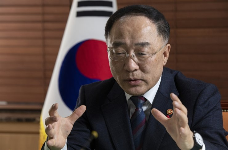 Finance Minister Hong Nam-ki speaks during an interview with The Korea Times at the government complex in central Seoul, Jan. 10. / Korea Times photo by Shim Hyun-chul