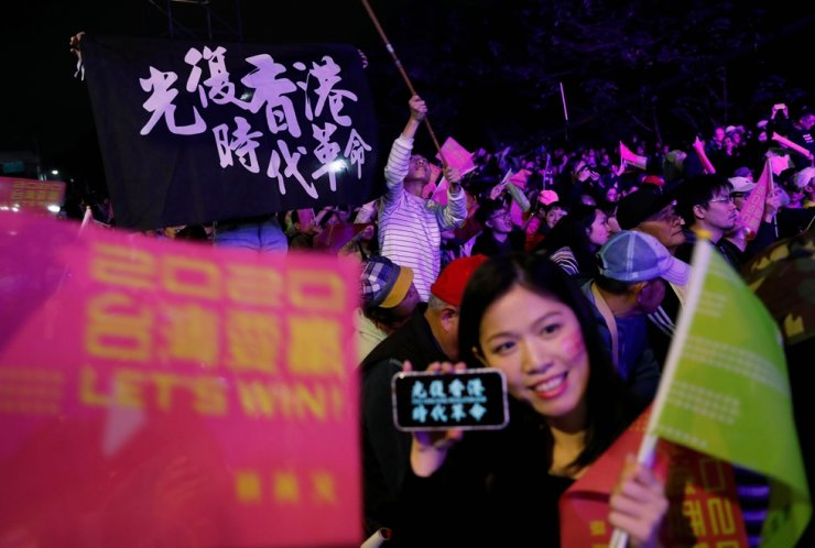 Hong Kong anti-government protesters attend a rally in support of Taiwan President Tsai Ing-wen outside the Democratic Progressive Party headquarters in Taipei, Jan. 11, 2020. Reuters