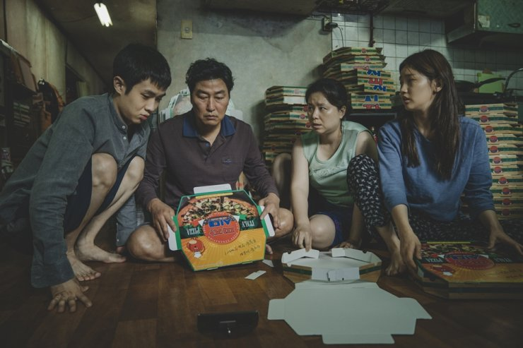 This image released by Neon shows Choi Woo-sik, from left, Song Kang-ho, Jang Hye-jin and Park So-dam in a scene from 'Parasite.' AP