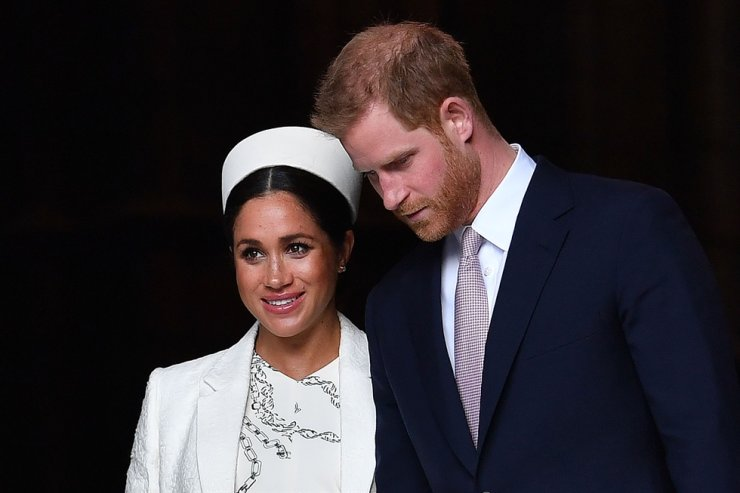 In this file photo taken on March 11, 2019, Britain's Prince Harry, Duke of Sussex (R) and Meghan, Duchess of Sussex leave after attending a Commonwealth Day Service at Westminster Abbey in central London, March 11, 2019. Queen Elizabeth II will host a showdown meeting with Prince Harry on Jan. 13, 2020, in an attempt to solve the crisis triggered by his bombshell announcement that he and wife Meghan were stepping back from the royal frontline. AFP