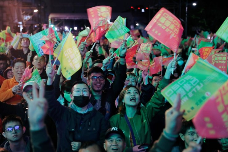 Supporters of Taiwan President Tsai Ing-wen celebrate the preliminary results at a rally outside the Democratic Progressive Party headquarters in Taipei, Taiwan Jan. 11, 2020. Reuters