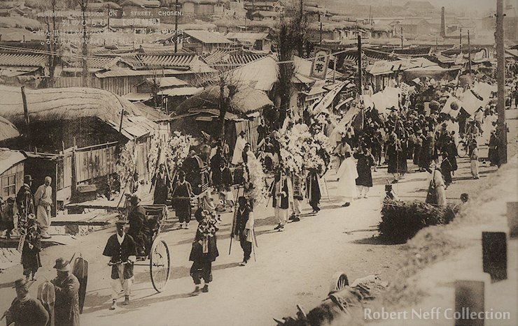 A Korean funeral going through the streets, circa 1910-1920s.  Robert Neff Collection