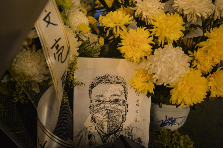 A card with a portrait of Dr. Li Wenliang at Li's hospital in Wuhan in central China's Hubei province, Feb. 7, 2020. EPA-Yonhap