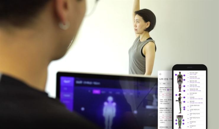 At GymT, a personal trainer analyzes a client's skeletal balance. Courtesy of GymT