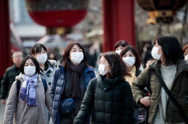 People wear face masks to help prevent the new coronavirus as they visit the Sensoji temple in Tokyo on Feb. 3, 2020. AFP