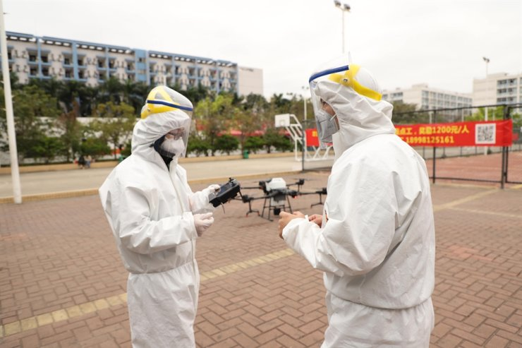 DJI technicians control drones used to spray disinfectant in public areas in an attempt to control 2019-nCoV in China, Feb. 17. The Chinese drone maker said Monday it signed a partnership with Hancom to launch a drone pilot training school in Korea. / Courtesy of DJI Korea
