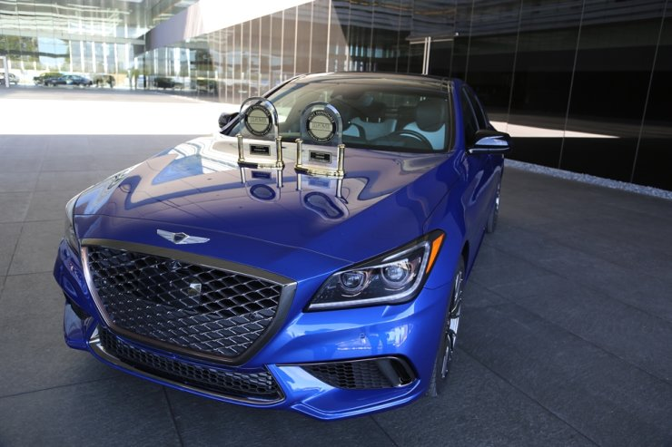 The Genesis G80 with trophies awarded by U.S. vehicle ratings firm J.D. Power. Genesis said it was recognized as the most dependable brand while the G80 was the top midsize premium car in the 2020 J.D. Power Vehicle Dependability Study. Courtesy of Genesis