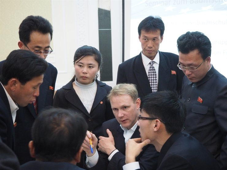 A German forester teaches North Korean state officials about forestry. Courtesy of Hanns Seidel Foundation Korea Office