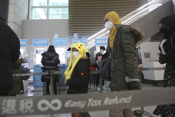 Passengers wear masks in a departure lobby at Incheon International Airport in Incheon, Monday, Jan. 27, 2020. AP