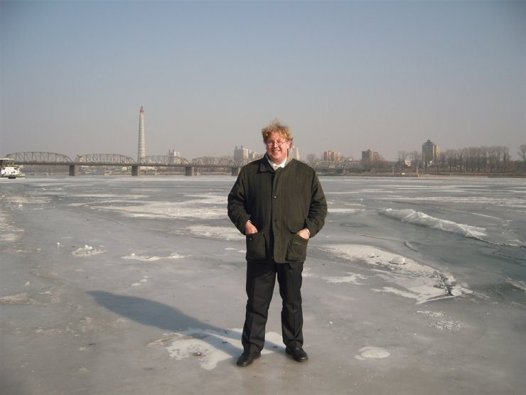 Bernhard Seliger at frozen Taedong River in Pyongyang. He has been supporting and internationally promoting Hanns Seidel Foundation Korea Office's environmental recovery works in North Korea since 2002. Courtesy of Hanns Seidel Foundation Korea Office
