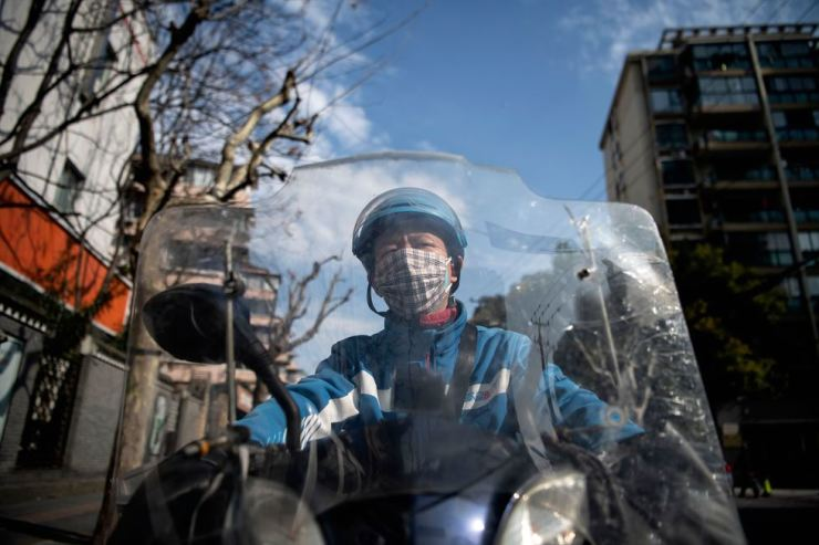 This photo taken on Feb. 19, 2020, shows motorcycle delivery worker Gao Yuchao, along a street in Shanghai. AFP-Yonhap