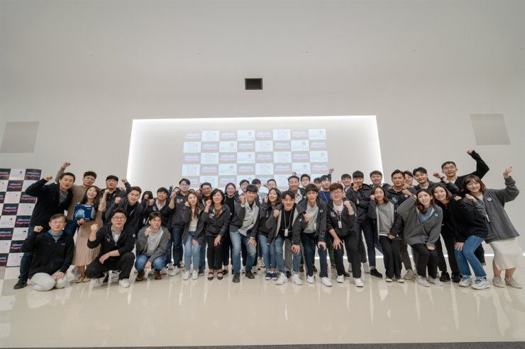 Hyundai Card's millennial employees pose at the company's in-house hackathon in this October 2019 file photo. / Courtesy of Hyundai Card