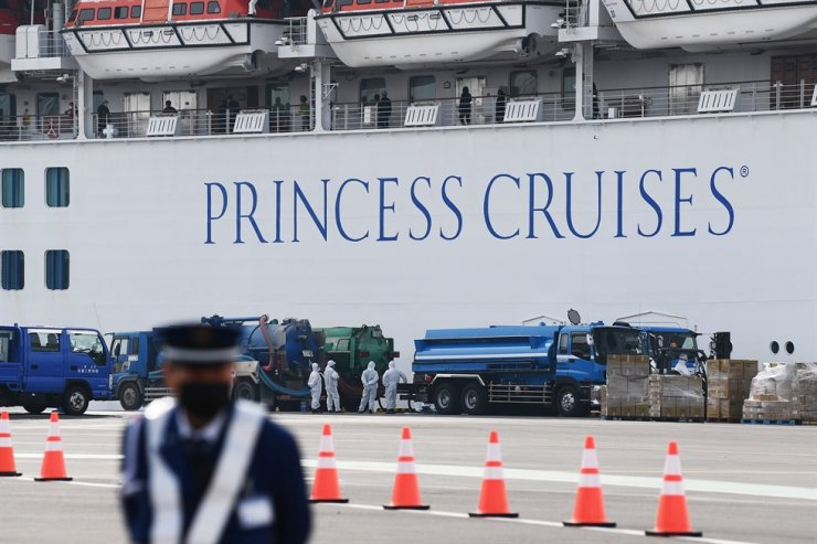 A security guard in front of the Diamond Princess, with around 3,700 people quarantined onboard due to fears of the new coronavirus. AFP