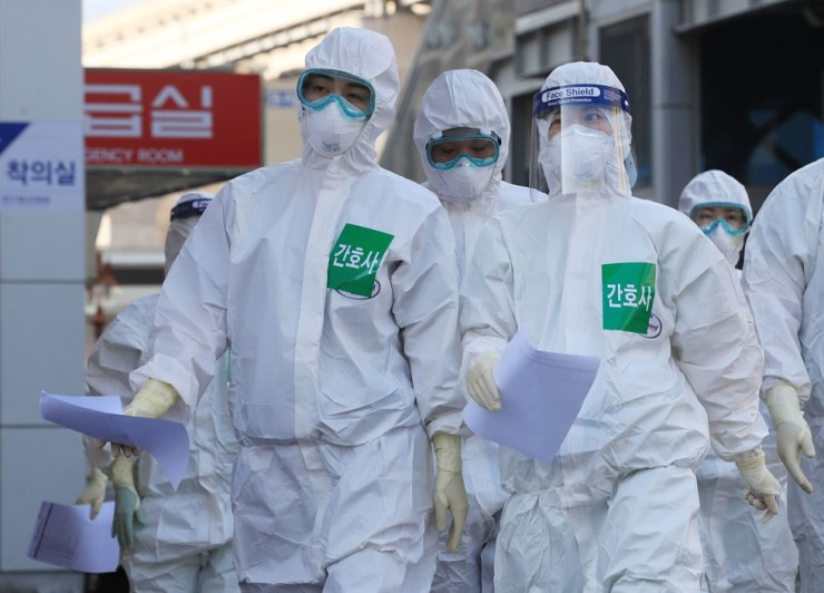 South Korea reported 100 new cases of the novel coronavirus Wednesday, up from 76 new cases a day earlier, bringing the nation's total infections to 9,137. Yonhap