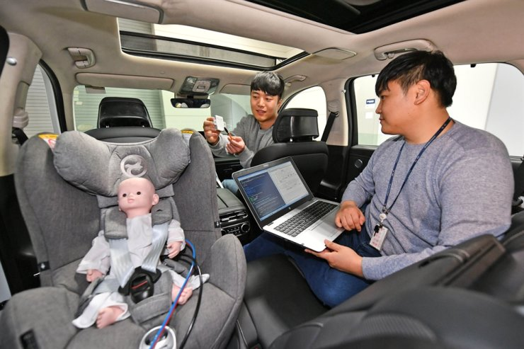 Hyundai Mobis engineers test the company's ultrasonic sensor-based rear occupant alert system in this undated file photo. Courtesy of Hyundai Mobis