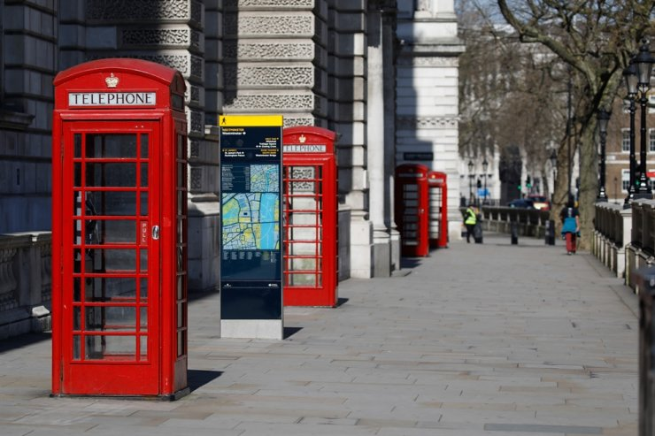 Empty telephone boxes are seen in a near-deserted central London on March 25 after the government ordered a lockdown to slow the spread of the novel coronavirus. AFP