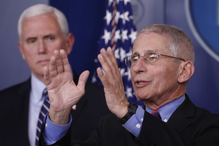 Dr. Anthony Fauci, director of the National Institute of Allergy and Infectious Diseases, speaks about the coronavirus in the James Brady Briefing Room, Wednesday, March 25, 2020, in Washington, as Vice President Mike Pence listens. AP