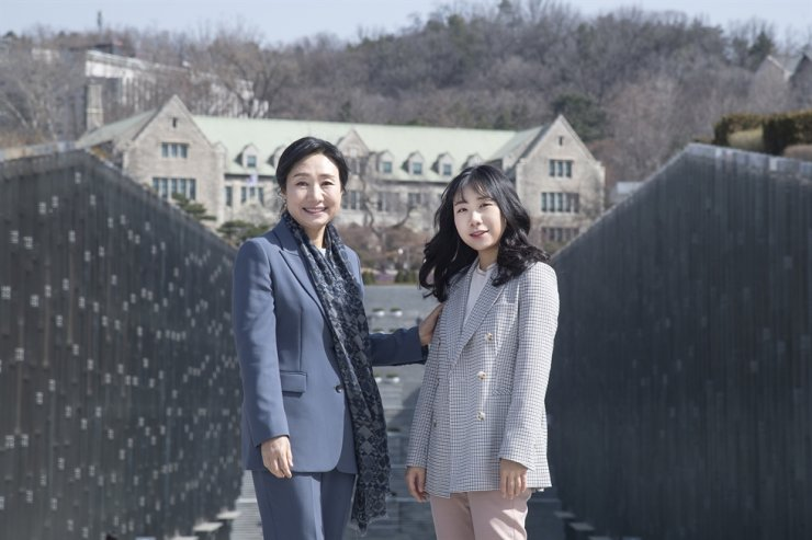 Kim Eun-suk, left, poses for a photo with her daughter Ko Eun-seok, at Ewha Woman's University campus in Seoul, March 20. /Courtesy of Ewha Woman's University