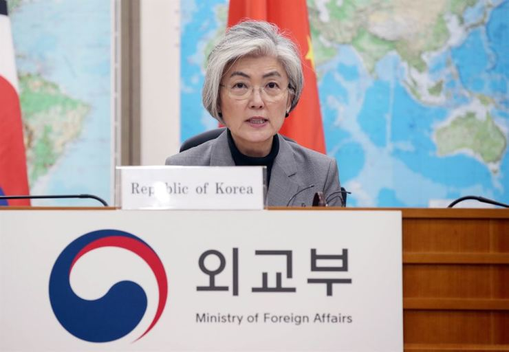Foreign Minister Kang Kyung-wha speaks during a teleconference with her counterparts from Japan and China, Friday. Yonhap