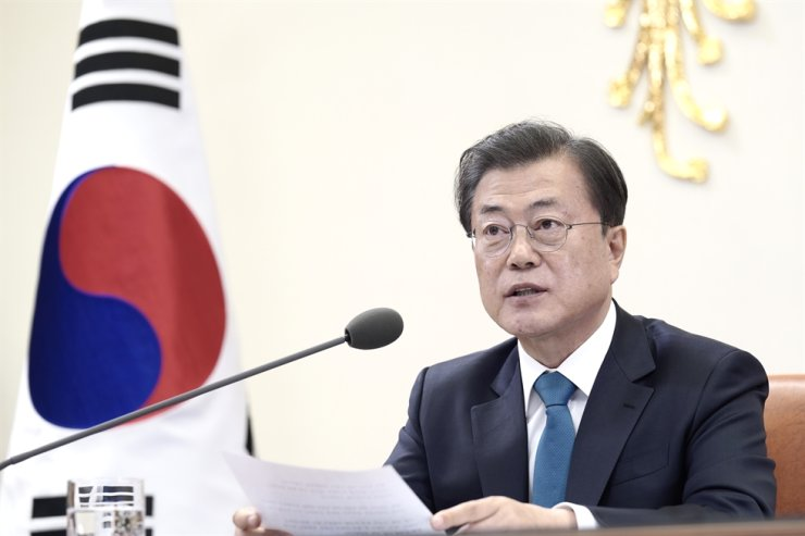 President Moon Jae-in speaks during a teleconference with G20 leaders from his office, March 26. The rival parties are using new campaign strategies for the April 15 general election as the world looks to Korea's model in fighting against the COVID-19 pandemic. / Courtesy of Cheong Wa Dae