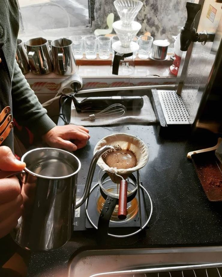 Lim, whose face is not seen in this photo, brews coffee at his coffee house located near the Hamdeok Beach on Jeju island in this December 2019 photo. / Photo from Lim
