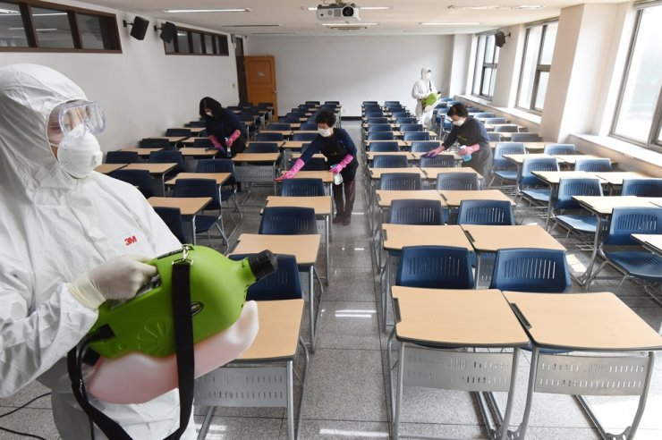 Staff disinfect the classroom at the Jukjeon Campus of Dankook University in Yongin of Gyeonggi Province, South Korea, April 7, 2020. South Korea reported 47 new COVID-19 cases compared to 24 hours ago as of midnight Tuesday local time, raising the total number of infections to 10,331. The newly confirmed cases stayed below 50 for the second consecutive day. Of the total, 17 were imported cases. (NEWSIS/Handout via Xinhua)