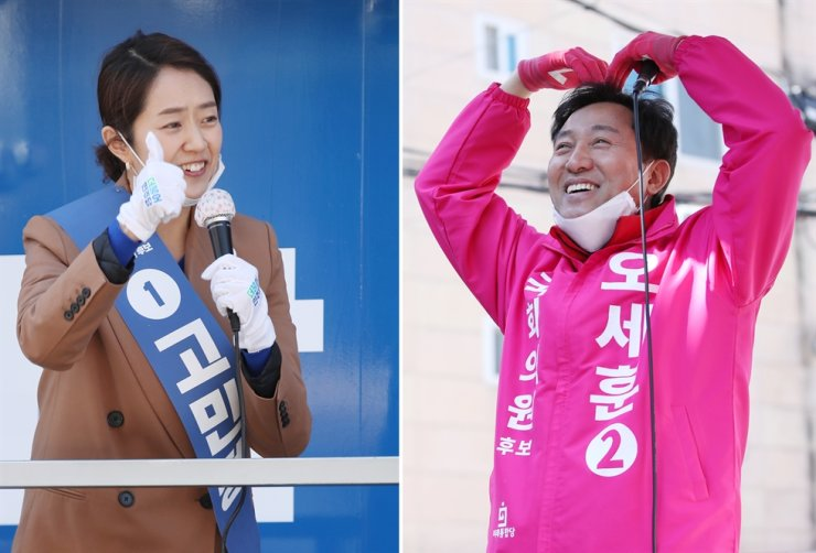 Ko Min-jung, left, the candidate from the ruling Democratic Party of Korea, and Oh Se-hoon from the main opposition United Future Party stage election campaigns in the Gwangjin-B constituency in Seoul, Wednesday. The rival candidates have received criticism for 'biased' remarks about homosexuality during their televised debate aired Sunday. Yonhap